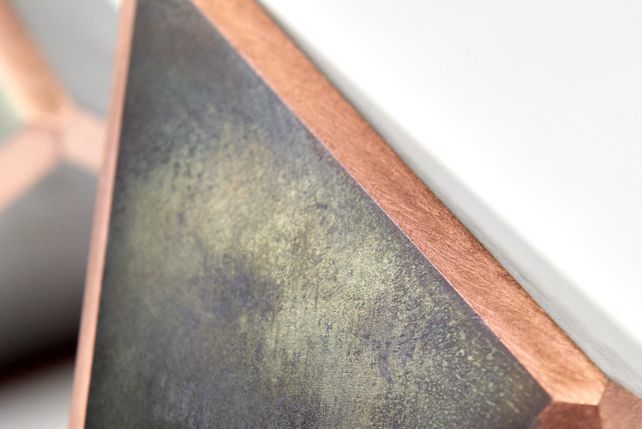 detail van het gelaste koper tussen de staalplaatjes
